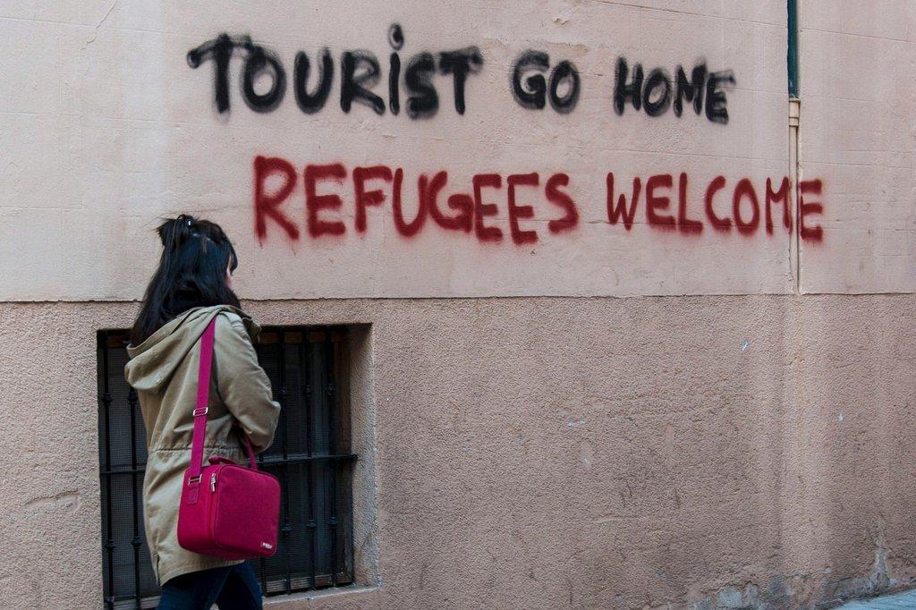 TouristGoHome | © picture alliance / dpa